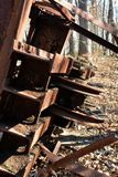 Oil Derrick detail. Pulleys at the top of a rusting collapsed oil Derrick in the forest stock image