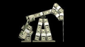 Oil derrick made of dollar wads Royalty Free Stock Photo