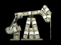 Oil derrick made from money Royalty Free Stock Photos