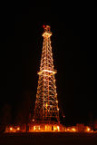 Oil Derrick at Night Stock Photos