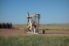 An oil derrick in the prairies Stock Image