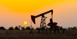 Oil derrick pumping crude. On nature landscape background , oil-extracting industry concept, horizontal photo royalty free stock photos