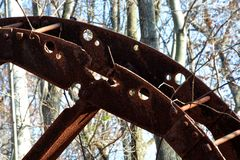 Oil derrick remains. Detail of a collapsed oil Derrick rusting on the forest floor royalty free stock images