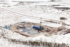 Oil derrick and road in tundra, view from above Royalty Free Stock Photos