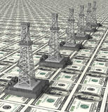 Oil derrick tower dollar power Royalty Free Stock Photography