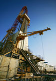 Oil derricks. Against the dark blue sky stock images