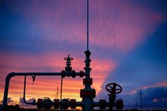 Oil derricks on a background of beautiful sunset. Kaliningrad, Russia Royalty Free Stock Image