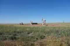 Oil derricks in the prairies Stock Photography