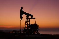 Oil derricks in sunset Royalty Free Stock Image