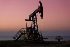 Oil derricks in sunset Royalty Free Stock Photography