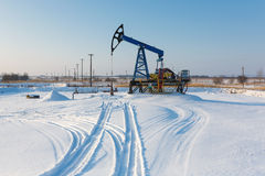 Oil derricks in winter. Oil derricks on snowy field at winter time Stock Photography