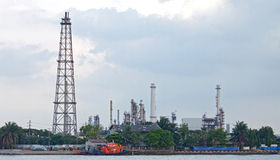 Oil distillation Tower. Landscape of Oil distillation Tower at refinery plant along river Stock Photos