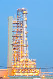 Oil Distillation tower. Distillation tower at Oil Refinery Plant at dusk Stock Photo