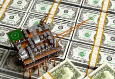 Oil and dollars. Stock Photography