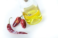 Oil and dried peppers. Studioshot of oil and dried peppers Stock Images