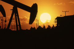 Oil drill. At sunset in California Stock Photography