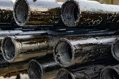 Oil Drill pipe. Rusty drill pipes were drilled in the well section. Downhole drilling rig. Laying the pipe on the deck. View of. The shell of drill pipes laid royalty free stock images