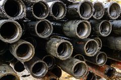 Oil Drill pipe. Rusty drill pipes were drilled in the well section. Downhole drilling rig. Laying the pipe on the deck. View of. The shell of drill pipes laid royalty free stock photography