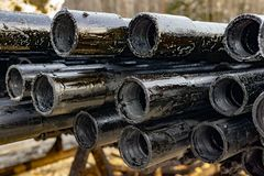 Oil Drill pipe. Rusty drill pipes were drilled in the well section. Downhole drilling rig. Laying the pipe on the deck. View of. The shell of drill pipes laid royalty free stock image