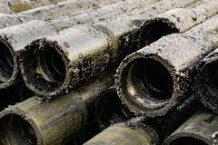 Oil Drill pipe. Rusty drill pipes were drilled in the well section. Downhole drilling rig. Laying the pipe on the deck. View of. The shell of drill pipes laid royalty free stock photos