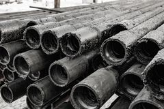Oil Drill pipe. Rusty drill pipes were drilled in the well section.   View of the shell of drill pipes laid in courtyard of the. Oil Drill pipe. Rusty drill royalty free stock image
