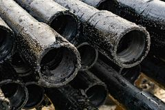 Oil Drill pipe. Rusty drill pipes were drilled in the well section. Downhole drilling rig. Laying the pipe on the deck. View of. The shell of drill pipes laid stock image