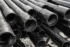 Oil Drill pipe. Rusty drill pipes were drilled in the well section.   View of the shell of drill pipes laid in courtyard of the. Oil Drill pipe. Rusty drill stock image