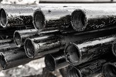 Oil Drill pipe. Rusty drill pipes were drilled in the well section.   View of the shell of drill pipes laid in courtyard of the. Oil Drill pipe. Rusty drill stock photography