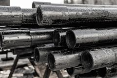 Oil Drill pipe. Rusty drill pipes were drilled in the well section.   View of the shell of drill pipes laid in courtyard of the. Oil Drill pipe. Rusty drill stock photo