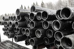Oil Drill pipe. Rusty drill pipes were drilled in the well section.   View of the shell of drill pipes laid in courtyard of the. Oil Drill pipe. Rusty drill stock images