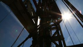 Oil drilling panorama. Oil rig bottom view panorama stock footage