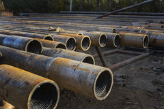 Oil drilling pipe. Pipes waiting to be used on an oil drilling rig Stock Image