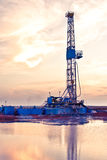 Oil Drilling Rig. Against an evening sky Royalty Free Stock Photos
