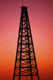 Oil drilling rig. At sunset Stock Image