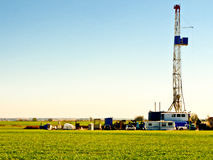 Oil Drilling Rig-8536. Oil drilling rig in the middle of a Oklahoma winter wheat field Stock Photos