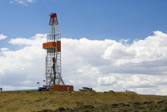Oil Drilling Rig. An oil drilling rig in the oil fields of Wyoming Stock Images