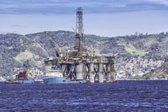 Oil drilling rig against panorama of Rio de Janeir royalty free stock photo