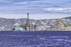 Oil drilling rig against panorama of Rio de Janeir Stock Photos