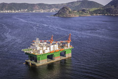 Oil drilling rig against panorama of Rio De Janeiro Stock Image