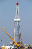 Oil drilling rig and crane. Heavy machinery Stock Photos