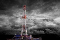 OIL DRILLING RIG. With Dramatic Cloud Background Stock Photo
