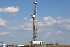 Oil drilling rig on field Stock Photography