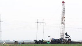 Oil drilling rig on field. Oil drilling rig with workers on field stock video footage