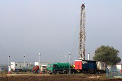 Oil drilling rig and gas station. Industry royalty free stock photo