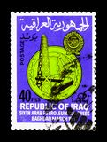 Oil drilling rig, oil pipeline, 6th Arab Oil Congress, Baghdad serie, circa 1967. MOSCOW, RUSSIA - NOVEMBER 23, 2017: A stamp printed in Iraq shows Oil drilling royalty free stock photos