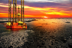 Oil drilling rig at sea in winter Stock Images