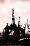 Oil Drilling Rig Silhouette Stock Images