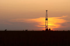 Oil Drilling Rig and Sunset Royalty Free Stock Images