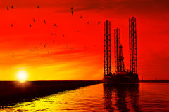 Oil rig at sunset Stock Photography