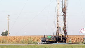 Oil drilling rig and workers. Land oil drilling rig and workers stock footage